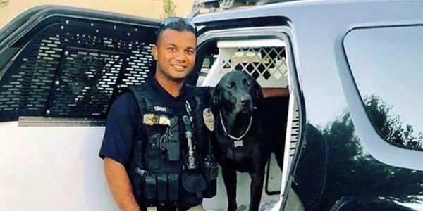 A slain police officer is being hailed as a 'Fiji-born American hero' who made the ultimate sacrifice for his adopted country