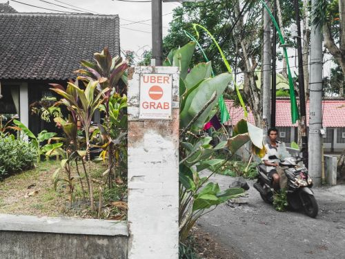 'Why should we make foreigners rich?': Taxi drivers are taking on Uber and Grab in Bali, and some are turning to violence