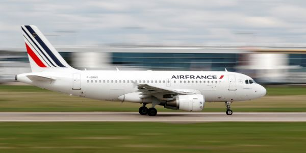 An Air France flight was forced to turn back in midair when staff found an unattended cell phone that didn't belong to any of the passengers