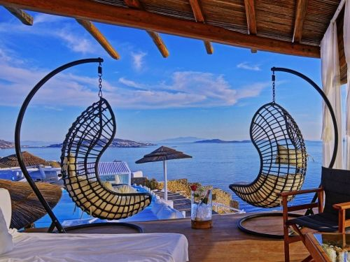 What a $1 million vacation looks like in Mykonos, Greece, where you'll fly in on a private jet, sleep in an ocean-view villa, and cruise the seas in a yacht