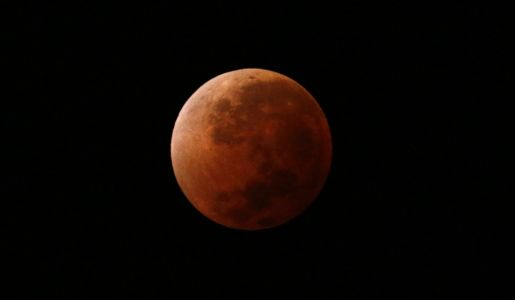 The longest total lunar eclipse in a century happens this week - here's the difference between a lunar and solar eclipse
