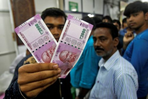 Indian rupee tumbles to record low amid spillover from 'full-blown currency crisis' in Turkey