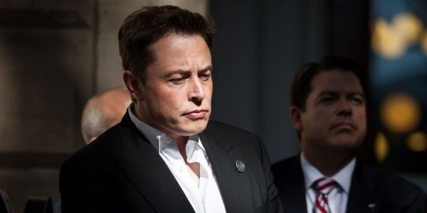 Elon Musk says he's hired Goldman Sachs to help take Tesla private - even though the bank's analyst is one of the most bearish on Wall Street