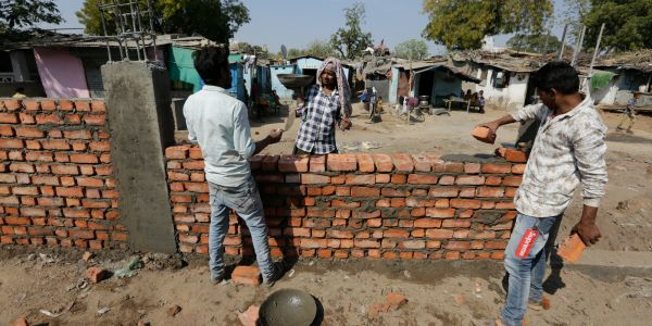India hastily erected a 7-foot wall so that Trump wouldn't have to see a slum on his way to a rally