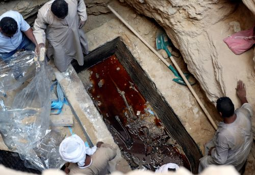 Archaeologists opened a mysterious black sarcophagus found in Egypt - and they discovered a gruesome scene