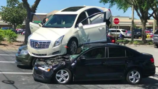 This Video Of An Out-Of-Control Cadillac XTS Climbing Two Cars Is Mind-Boggling