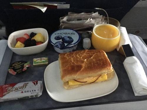 Delta is testing out 3-course meals and sparkling wine for economy passengers