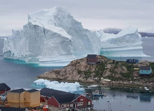 A 300-foot high iceberg is approaching Greenland, and this photo is the latest sign that Mother Nature has had it
