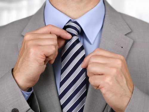 Wearing a tie could be making you ill, according to scientists