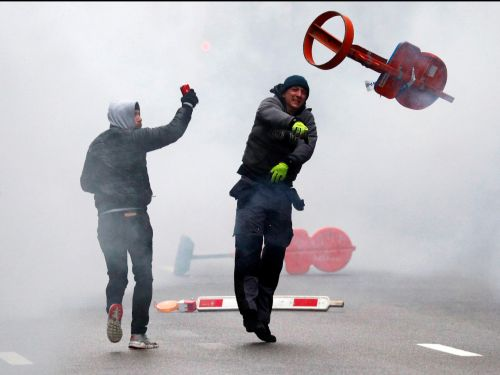 Dramatic photos show far-right activists getting pelted with a water cannon during a migration protest in Brussels