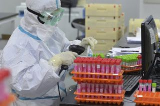 China reports 2 virus cases after mass testing