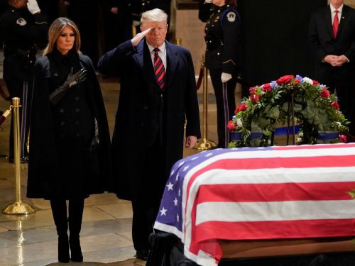Trump salutes casket and pays tribute to former President George H.W. Bush in the Capitol Rotunda