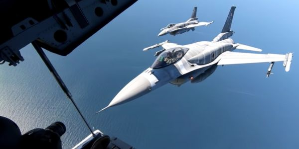 Behind the scenes of an up-close-and-personal midair photoshoot with 2 Polish F-16s