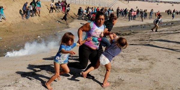 Mom pictured fleeing with her kids from tear gas at the US border says she never thought Border Patrol would use it on children