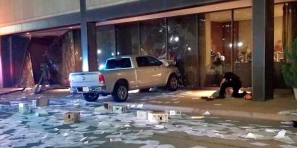 Police detained a man who repeatedly crashed his truck into a Dallas TV station