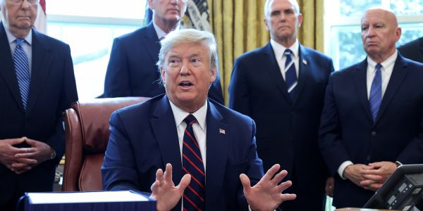 Trump signs the $2 trillion coronavirus economic relief bill into law, which includes checks for Americans and business loans