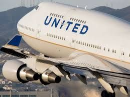 United Airlines downgrades fliers, pays $90,000 in travel vouchers