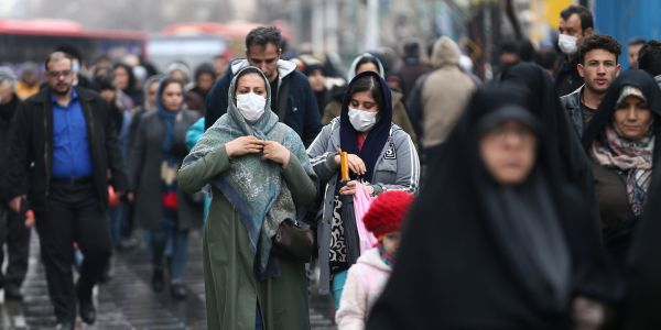 Iran is closing schools, scrambling for hospital places, and spraying disinfectant in the subway as coronavirus deaths and cases spike