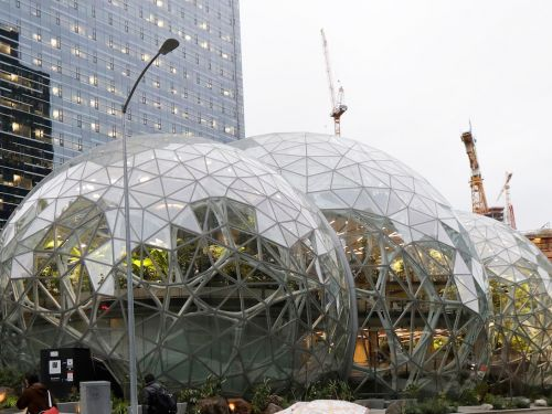 Jeff Bezos closes out Prime Day by standing on top of Amazon's massive glass spheres wearing climbing ropes and a hard hat