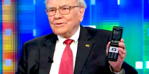 Warren Buffett has traded his flip phone for an iPhone, and says Apple is 'probably the best business I know in the world'