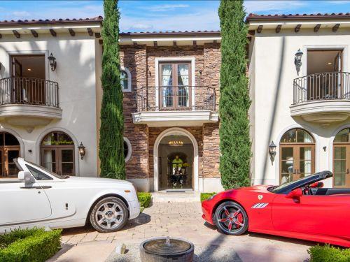 A Beverly Hills mansion replete with COVID-19-era amenities like a coronavirus cleaning room and a 'Zoom room' is on the market for $18 million. Take a look inside