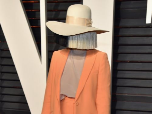 Sia showed up a party without one of her signature giant wigs - and it's one of the few times we've ever seen her face